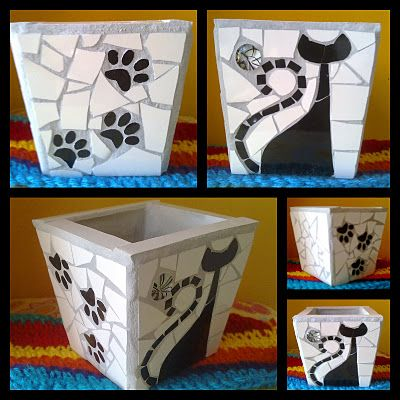 Que cosa fuera corazón, que cosa fuera...: 30/10/11 - 6/11/11 black and white mosaic pot planter with cat silhouette and dog paw prints. Love it!