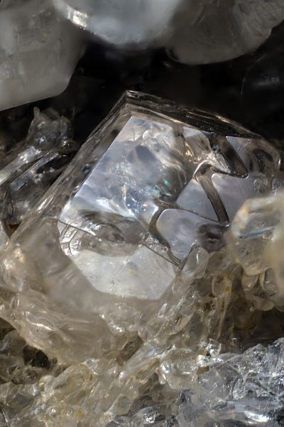 Liottite, (Ca,Na,K)8(Si,Al)12O24[(SO4),(CO3),Cl,OH]4•(H2O) ,(CO3),Cl,OH]4•(H2O) , Mt Saliette, Valentano, Làtera volcano, Viterbo Province, Latium, Italy. Fov 2 mm.Transparent crystal of Liottite. Specimen and Photo Bruno Marello