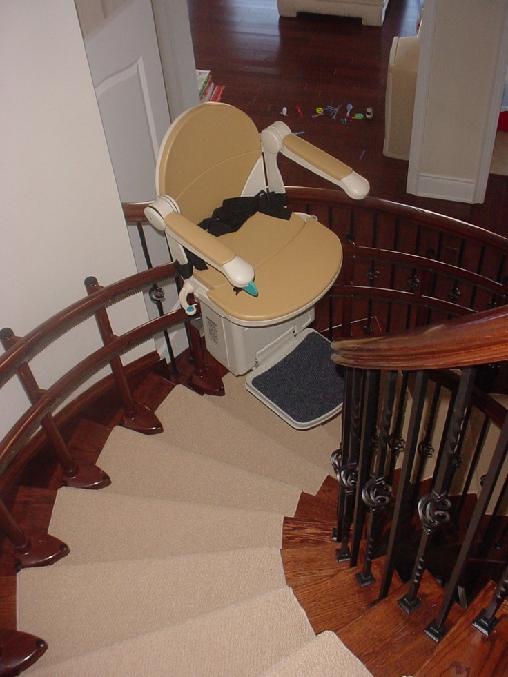 Curved Stair Lift With Custom Rail To Match Woodwork.