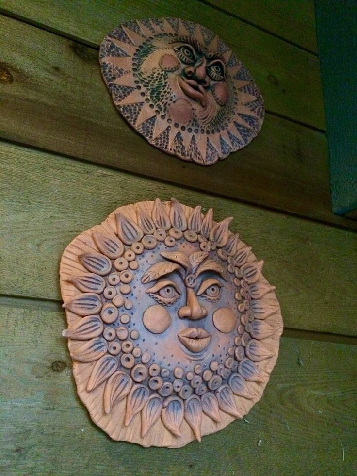On the subject of hiding... I took this sun face down outside my studio door recently to take to school.  I wanted to use it as an example for the students since they are starting this project in clay.  After removing it, I was startled to discover something on the wall that had been hidden by the sun face!