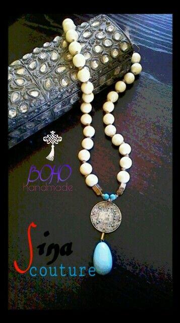 Collana ealizzata con perle smaltate,elenti in turchese e grande ciondolo in argento tibetano con inserti in corallo e turchese.
