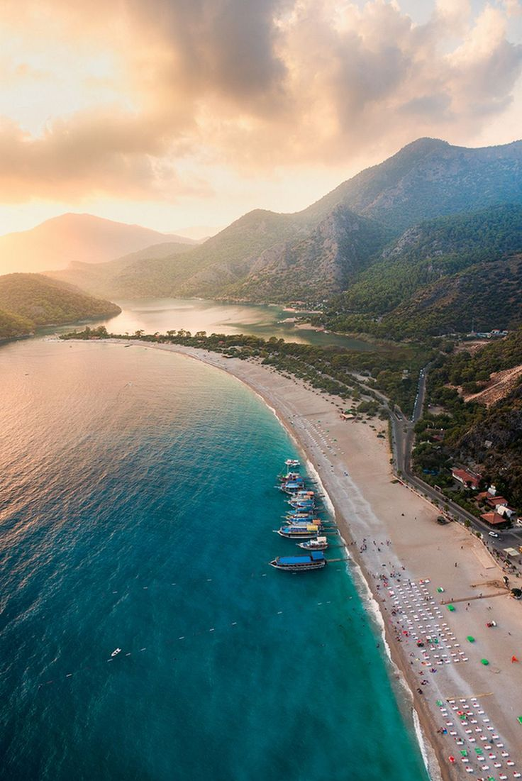 Oludeniz, Turkey - Ölüdeniz (literally Dead Sea, due to its calm waters even during storms; official translation name Blue Lagoon) is a small village and beach resort in the Fethiye district of Muğla Province, on the Turquoise Coast of southwestern Turkey, at the conjunction point of the Aegean and Mediterranean seas. [Text from wiki]