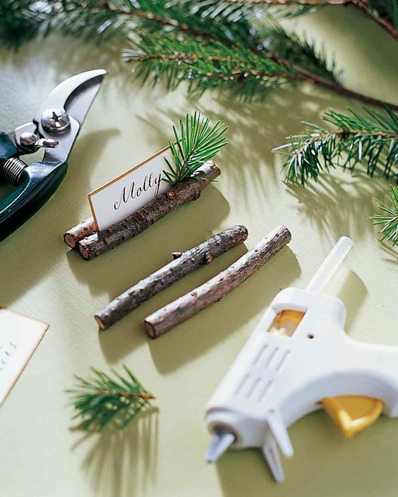 DIY Tree Branch Place Cards:Adding some evergreen sprigs to escort cards is a subtle way to bring Christmas to each place setting. This woodsy project is ideal for winter holiday gatherings or a mountain inspired wedding. | 10 DIY Escort Cards for Your Holiday Events and Weddings