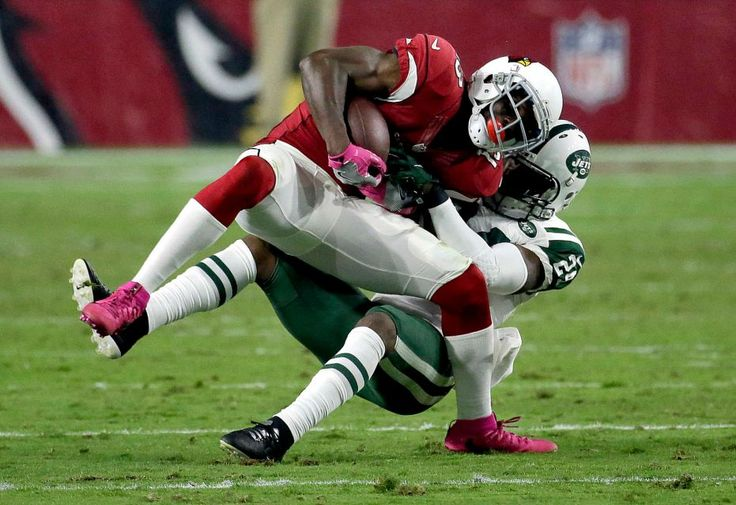 Monday Night Football: Jets vs. Cardinals:     October 17, 2016  -  28-03, Cardinals  -     Arizona Cardinals running back David Johnson is tackled by New York Jets cornerback Darrelle Revis (24), rear,during the second half of an NFL football game, Monday, Oct. 17, 2016, in Glendale, Ariz.