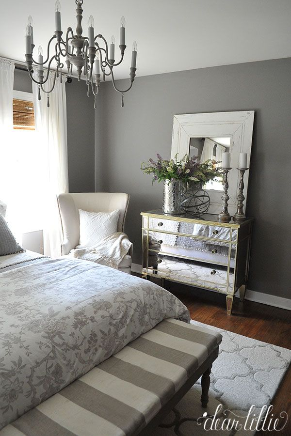 To create warmth using a cool color, layer thick textures like a wool rug and linen upholstered chairs. Try combining multiple patterns in the same hue to create visual interest. For a glamorous look, finish the room off with mirrored furniture and pieces with nail-head trim.