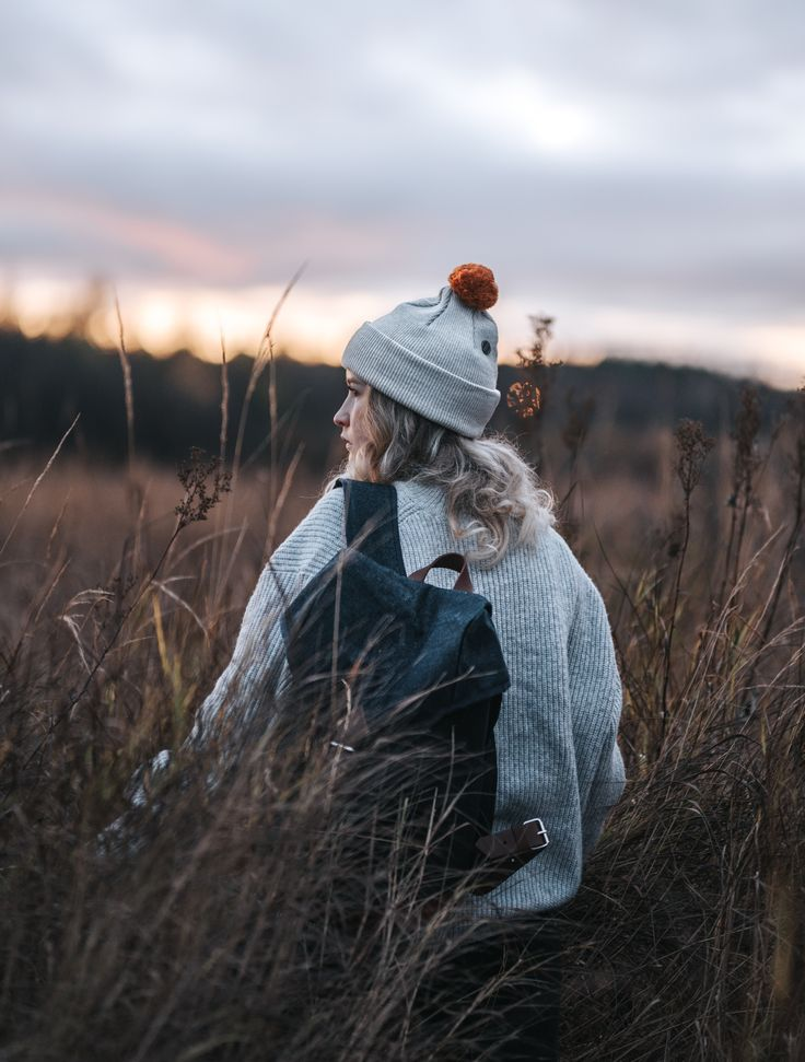 Wau beanie of merino wool and Waris backpack of recycled materials by COSTO. Photograph by Sanni Vierelä in Finnish Lapland