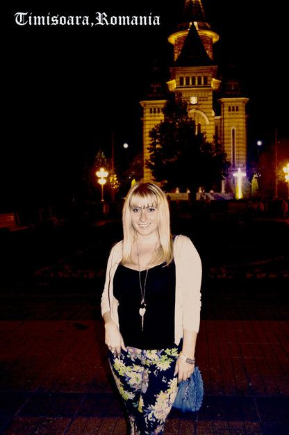 Travel to Romania! I mean it!  I'm in front of the Cathedral in my hometown Timisoara. Western Romania.