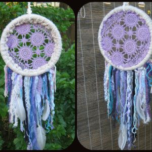DREAM OF PURPLE HAZE Materials Used: donated wools, strings, mesh; lace from curtains & old shirts; homemade pen-dyed doily & materials; real white feathers (found&cleaned); cardboard ring.  Measures: 22cm diameter, 33cm frills https://www.facebook.com/RawRoughRecycled