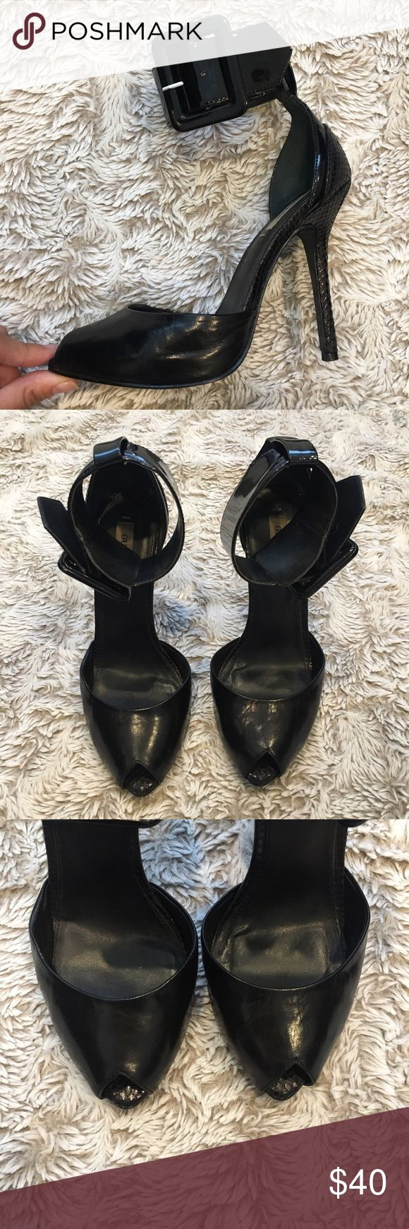 Black peep toe heels Black peep toe heels with thick belt ankle strap. Used a couple times as seen on bottom of the soles Guess Shoes Heels