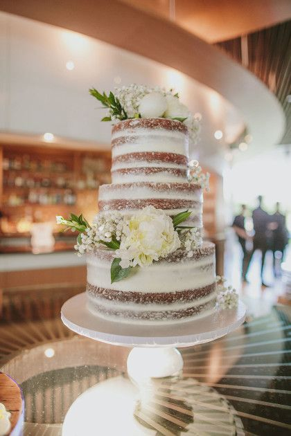 We love this nearly naked cake! See more from this whimsical OKC wedding from XO Events & Design | Angela + Jared on the Brides of Oklahoma blog! #bridesofok