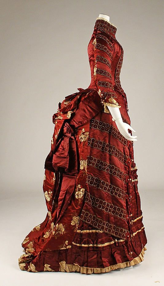 1879 extant gown from the MET. A delicious French made silk, almost could be a Xmas ornament. Love all the little details and various fabrics.