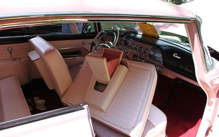 """The Original """"Pink Ladies"""" Car, complete with Lipstick Holder and Pink Umbrella"""