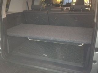 Simple, low-tech DIY rear cargo shelf complete! - Toyota FJ Cruiser Forum - I often times need to transport my gear from workplace to workplace, & I really don't like to just pile it in the back. So, I needed a more organized way to pack it in. Hence, my fairly inexpensive solution is here. It took me about 12-15 hours total to build, and I think it turned out decent. I made it all easily removable, in one piece. I reinforced the shelf w/steel wall shelving backets, so the shelf won't sag.