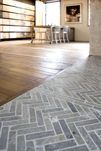 Herringbone slate floor in entryway meets original hardwood in living room