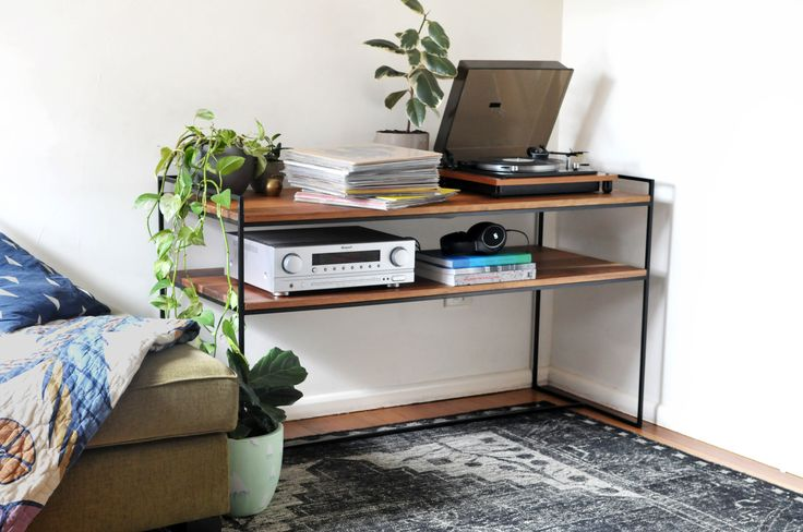 Custom built steel and timber entertainment unit for record player, amplifier and storage.