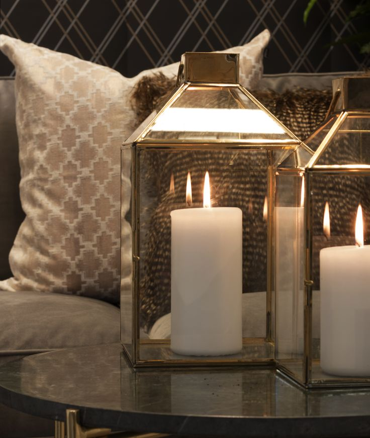 Gold lanterns, soft cushions and marble table.