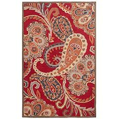 The Red Paisley Tufted Wool Rug from Pier 1 makes a high impact in any space with its georgious color contrast and large paisley print its not overbearing!