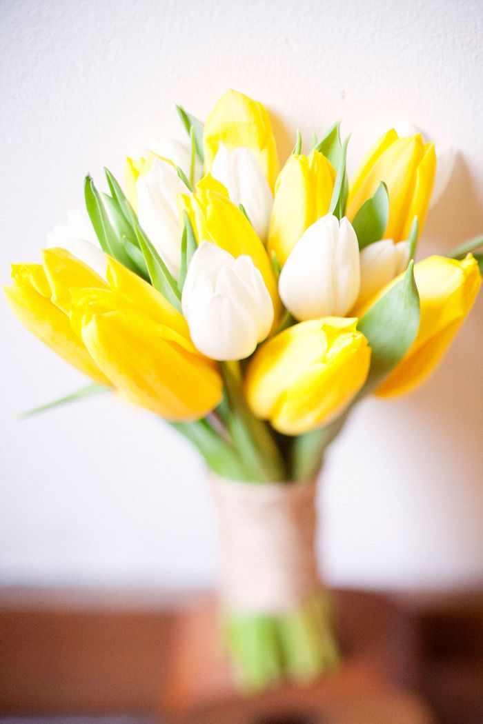 Yellow tulip bouquet - for your bridesmaids, all yellow tulips, wrapped with stripped ribbon (either green and white or yellow and white).
