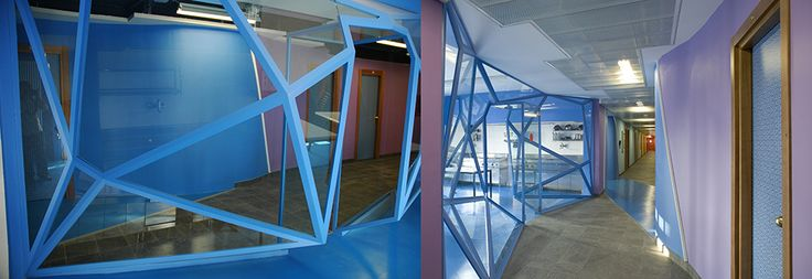 Collegio Universitario Einaudi, Sezione San Paolo, scorci del piano blu con le vetrate poliedriche della sala studio e della cucina.