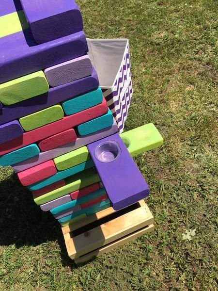 Jello Shot Jenga/Tumblers Who ever said you have to be boring with tumblers. That's right now you can pull from a secret compartment and bam you have to do a jello shot.  This Kit Includes (1) recipe to make jello shots  (1) 54 blocks measured 2x4 and are 18 rows high for 4 1/2 feet of fun to start your game with (1) Pick up to 5 colors to choose for your game (1) 50 jello shots cups (2) jello flavors  (2) containers to place the tumblers in     This products takes 2 weeks to prepare and…