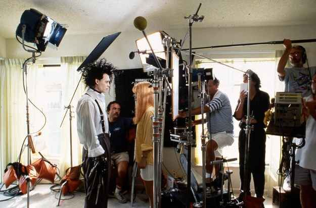 Johnny Depp and Winona Ryder share a scene as Tim Burton watches.
