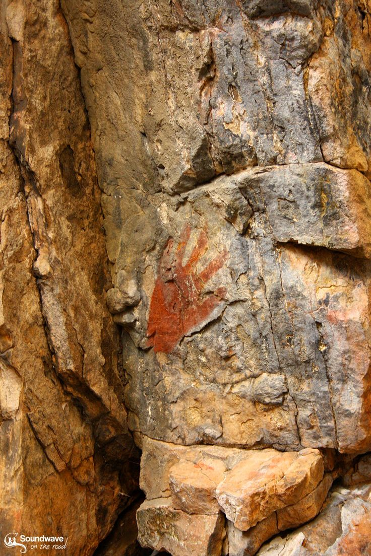 Red hand painting on a rock