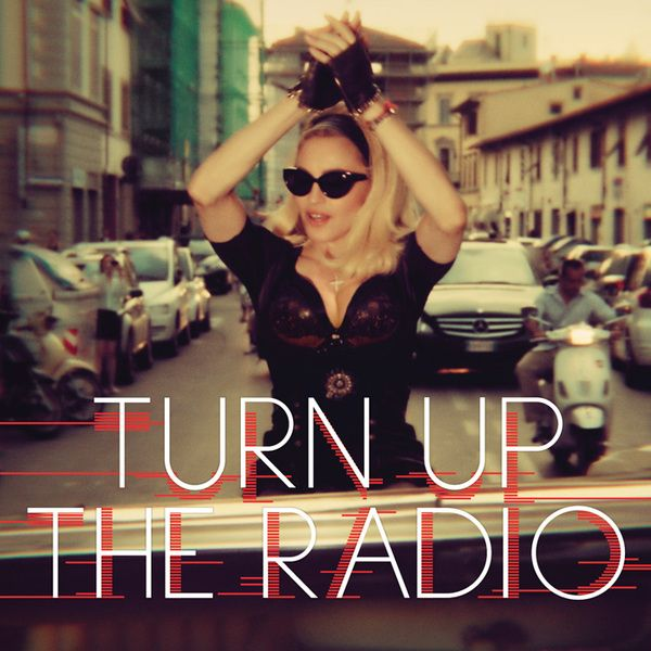 """The queen of pop is wearing a #La# Perla leather bra on the cover of her new album """"turn up the radio"""""""