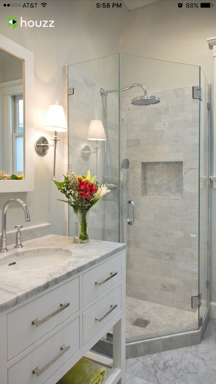 Small in space but big on taste. marble or quartz counters with frame-less tiled shower