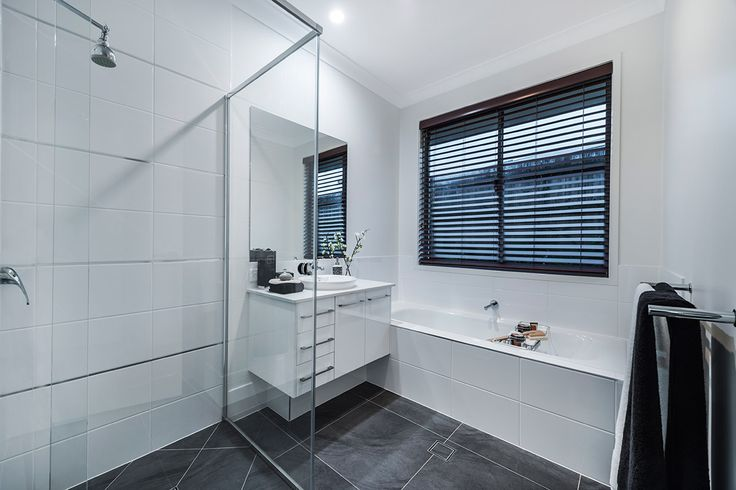 #Bathroom #style ideas from #Ausbuild's Allendale display #home. www.ausbuild.com.au. This #Bathroom presents a clear, chic look, with a glass #shower #door and fresh white #walls.