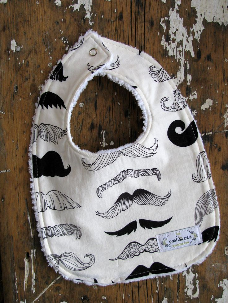 "Chenille Baby Boy Bib - Moustache in Black & Off-White - ""Where's my Stache"". $9.50, via Etsy."