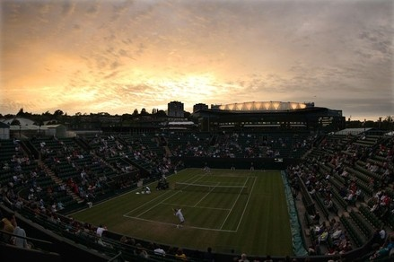 LONDON, ENGLAND - JUNE 27:  A general view of Court 2 as night falls and Richard Gasquet of France serves the ball during his Gentlemen's Singles second round match against Ruben Bemelmans of Belgium on day three of the Wimbledon Lawn Tennis Championships...