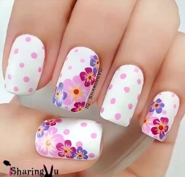 Go with hues of violets and create a fun and refreshing floral design with a polka dot background.