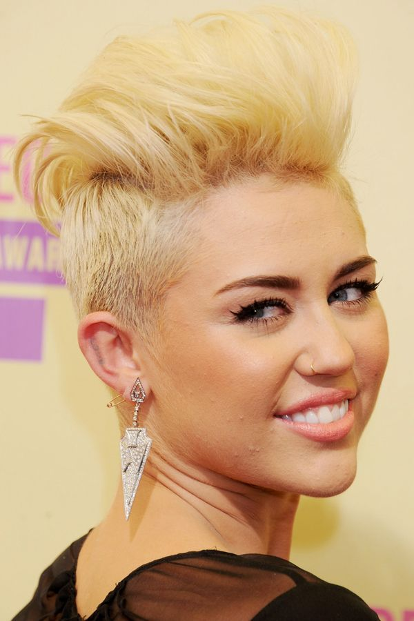 September 2012BOOM! Four months later, Cyrus debuted her new buzzed-and-bleached locks at the MTV Video Music Awards in Los Angeles.  #refinery29 http://www.refinery29.com/2015/11/98068/miley-cyrus-makeup-beauty-looks#slide-11