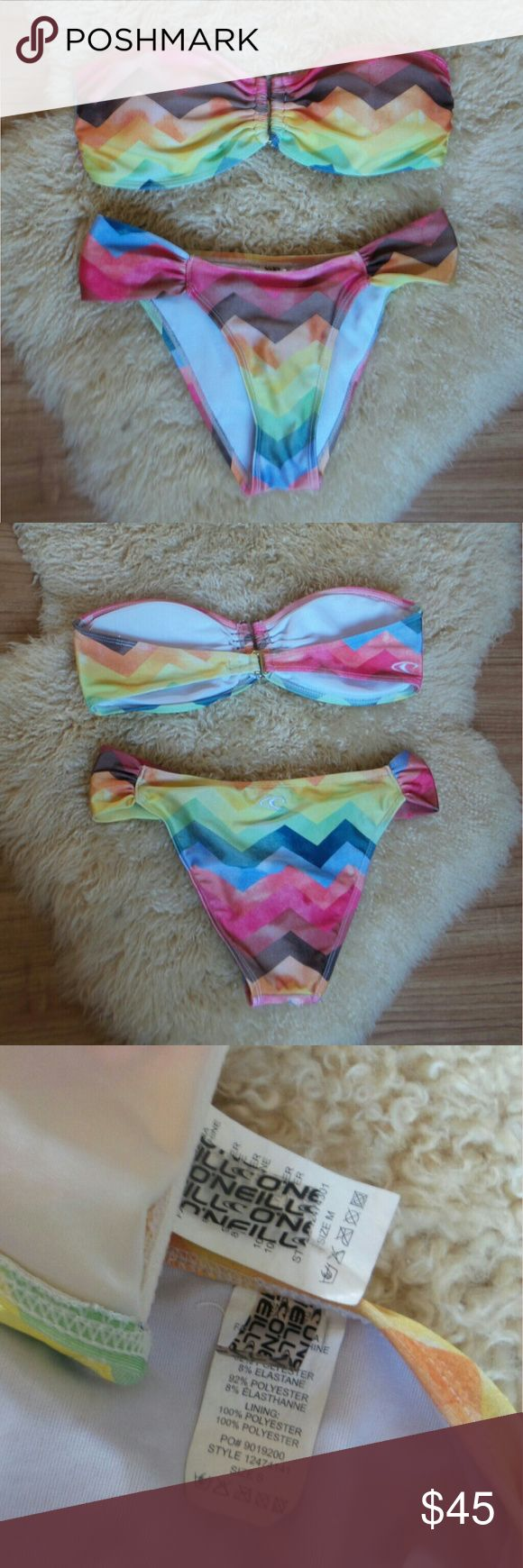 O'Neill Rainbow Chevron Bikini M Top/S Bottom Cute and quality bikini in great condition, no flaws! Bottoms would fit sizes 2-4, bandaeu top would fit c/d cups. O'Neill is similar to surf brands like Volcom, Billabong, Rip Curl, Roxy, RVCA, Reef, ect. O'Neill Swim Bikinis