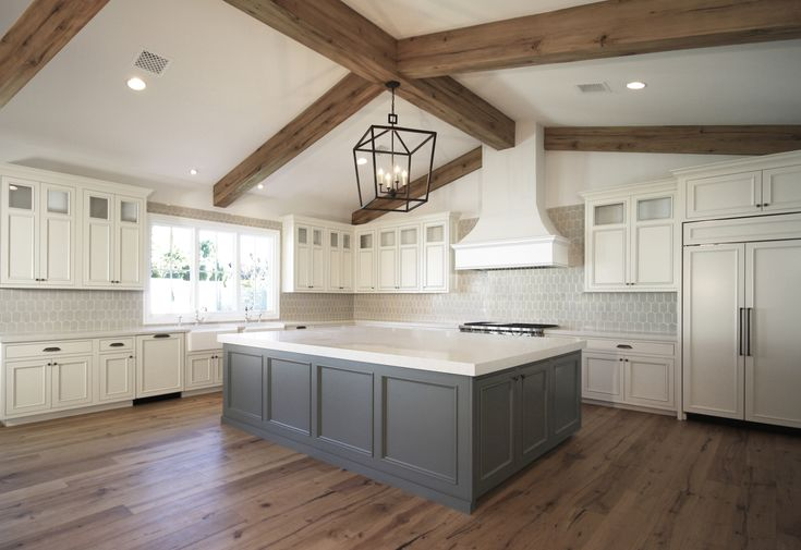 Large Kitchen Island with Vaulted Exposed Beams Ceiling