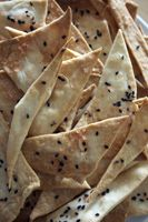 Olive oil crackers with Hawaiian sea salt and black sesame seeds.
