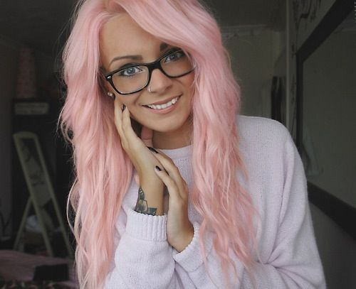 Pink hair and thick Rimmed glasses