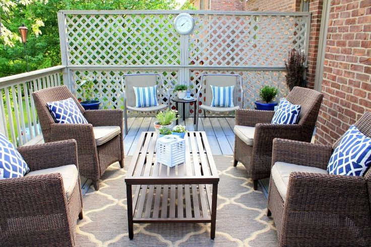 Several Ways For Decorating Target Outdoor Rugs Ideas: Amazing Target Outdoor Rugs With Rounded Wall Clock, Blue Cushions And Rattan Chairs Also Narrow Table
