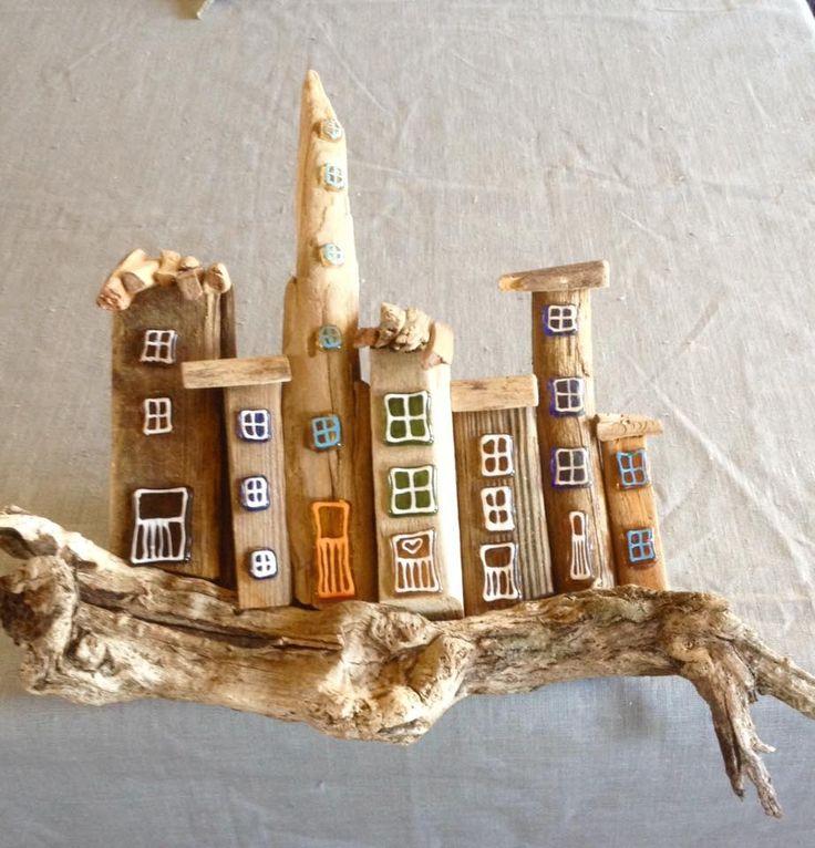 Huse lavet af drivtømmer og glas