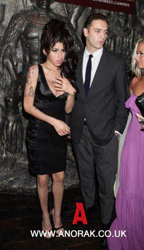 9271281 - Amy Winehouse and boyfriend Reg Traviss attend the press launch of Shaka Zulu, at Stables Market in Camden, north London.