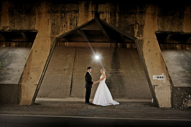 Bride & Groom + arch under bridge