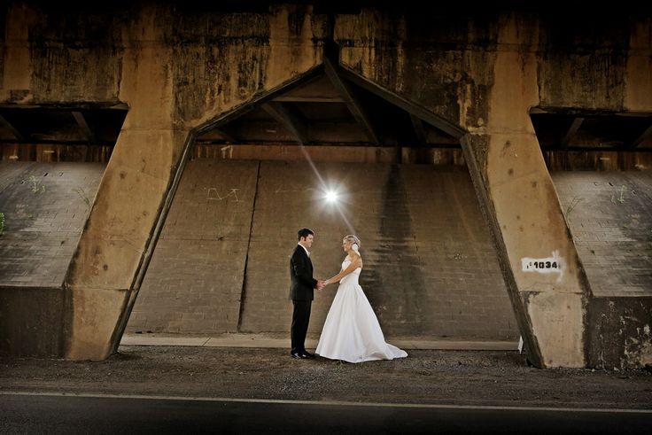 Bride & Groom + arch under bridge