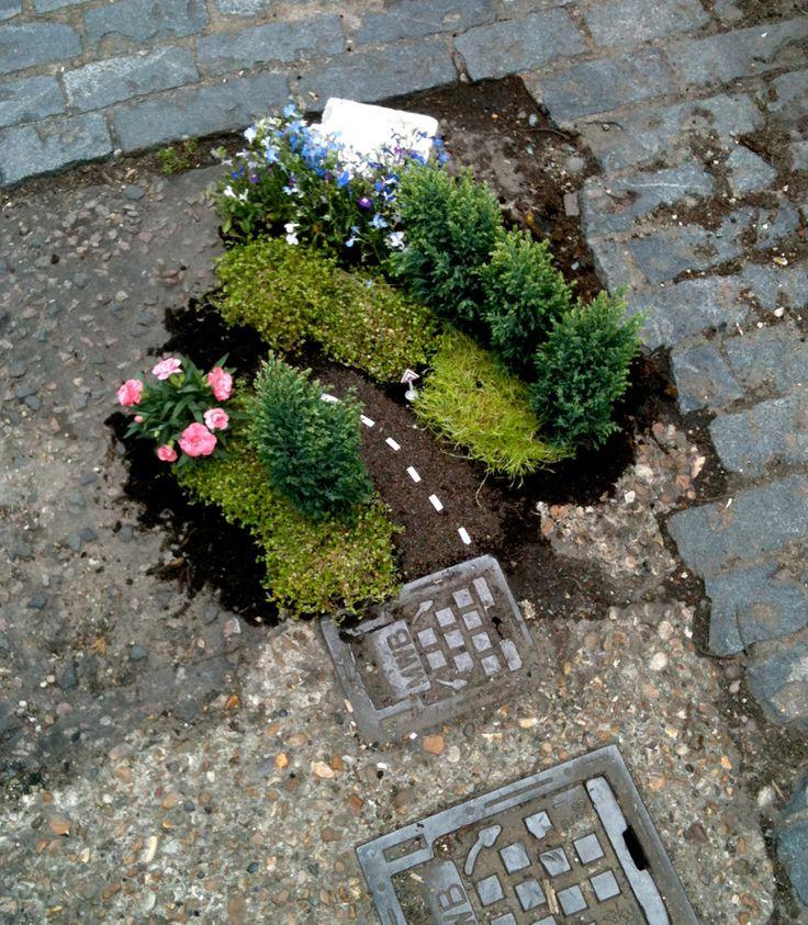pothole garden!  designboom.com: Tiny Gardens, Guerilla Gardens, Fairies Gardens, Minis Gardens, Street Art, Guerrilla Gardens, Gardens Projects, Pothol Gardens, Miniatures Gardens