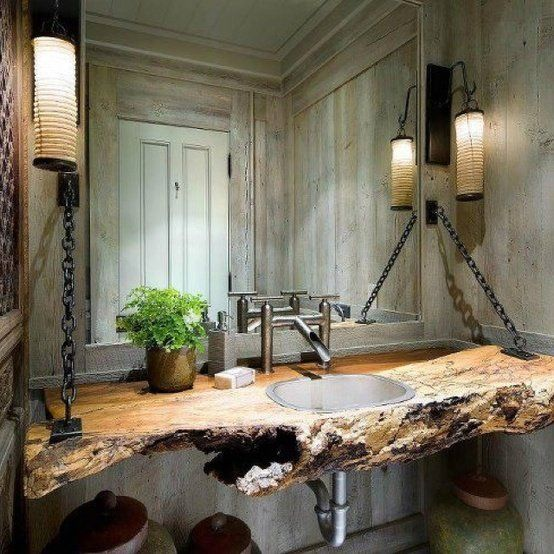 Incredibly creative and unique, this clever use of reclaimed wood gives this bathroom countertop a rich and warm, rustic yet modern appeal. Resistant to spills, strong and beautiful, reclaimed wood countertops need not only be limited to the kitchen. The uses for barn wood are limitless!