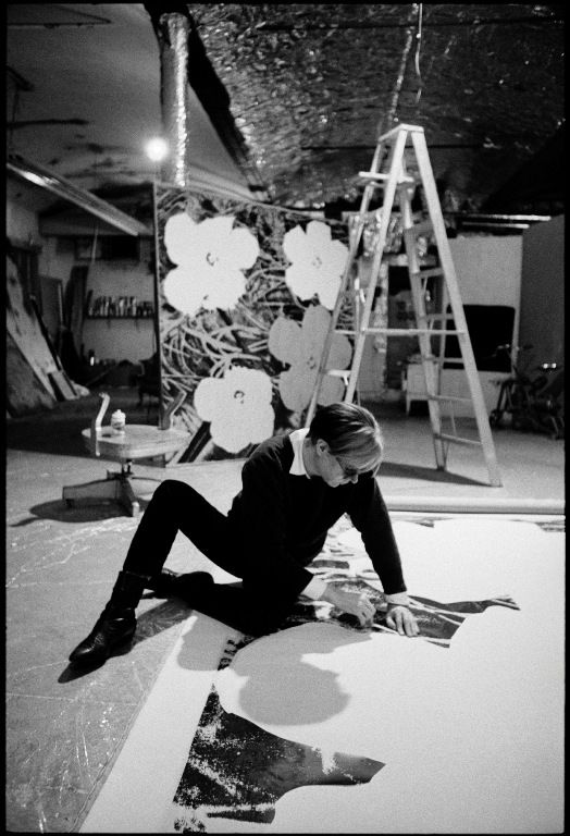 'Andy Warhol working on a 'Flower' painting at The Factory, New York, March 1965