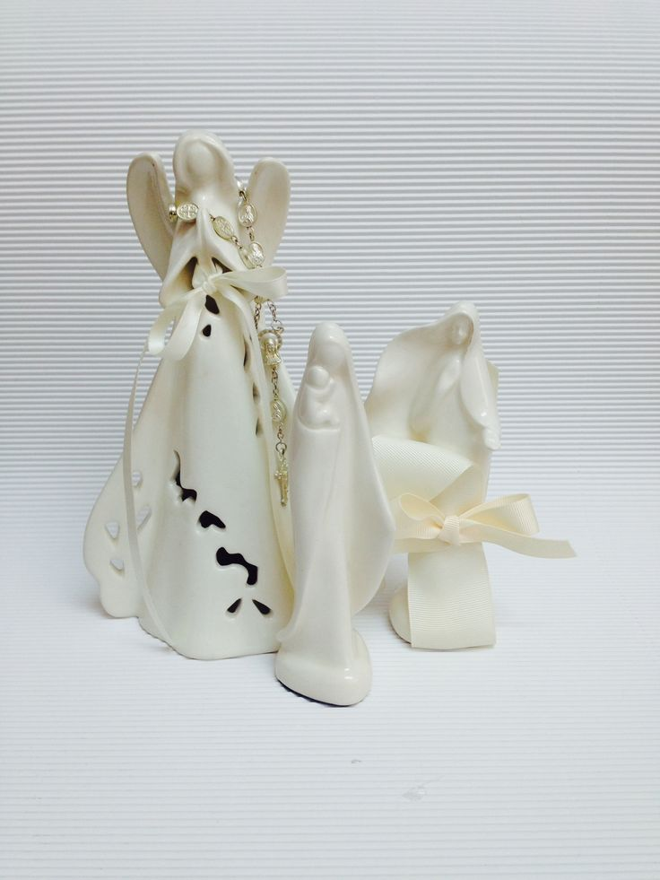 Porcelain Virgin Mary statuettes with silver rosary