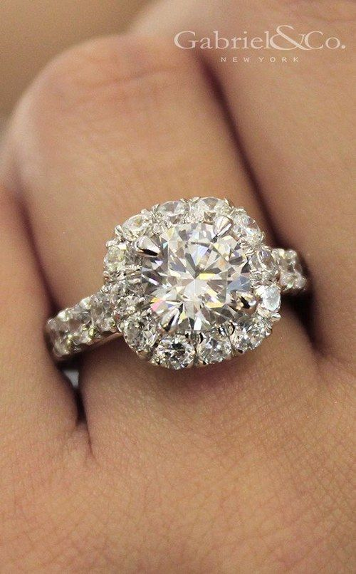 18k white gold diamond engagement ring, featuring a half diamond band and dazzling diamond halo via Gabriel & Co.