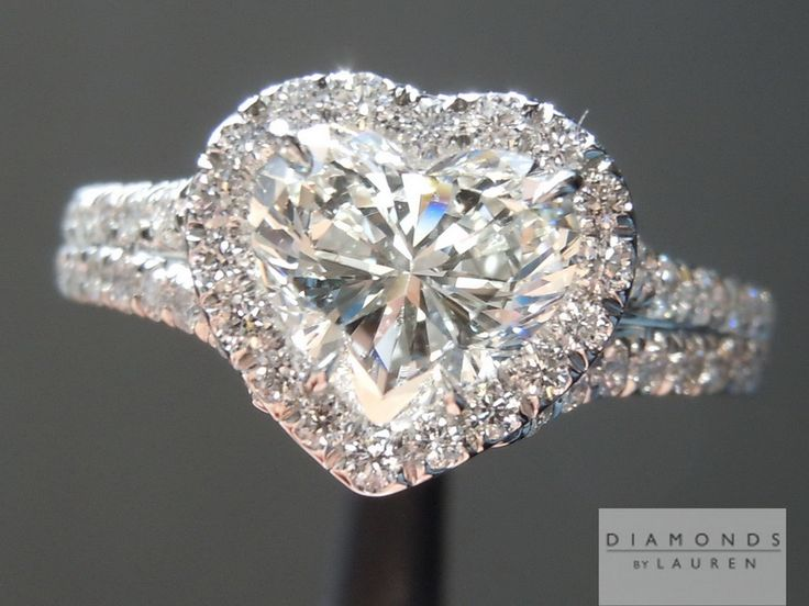 This hand forged halo is perfect for this beautifully cut heart shape diamond.