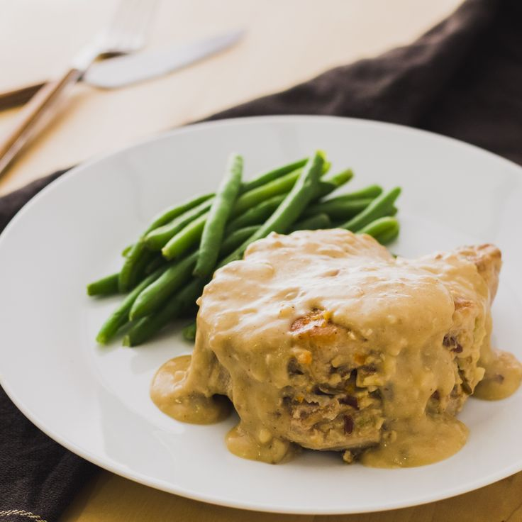 Not only are these tender pork chops slathered in creamy gravy, but they're stuffed with bacon and wild rice too.