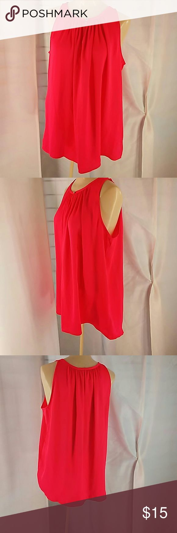 Jennifer Lopez shirt tail hem Blouse. NEON PINK!  Neckline has a halter look. Baring the shoulders. Size L 100% Polyester. It runs large. You can't help but be seen in this brilliant color. Looks magnificent with white pants or skirt or shorts. Jennifer Lopez Tops Blouses